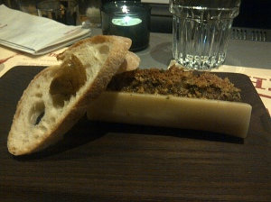 Baked Smoked Bone Marrow, onion jam, & sourdough, gentleman's relish butter